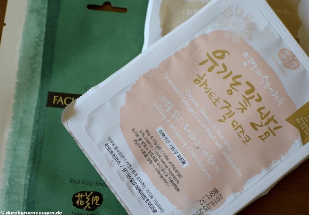 Drei Gesichtsmasken von der koreanischen Firma Whamisa